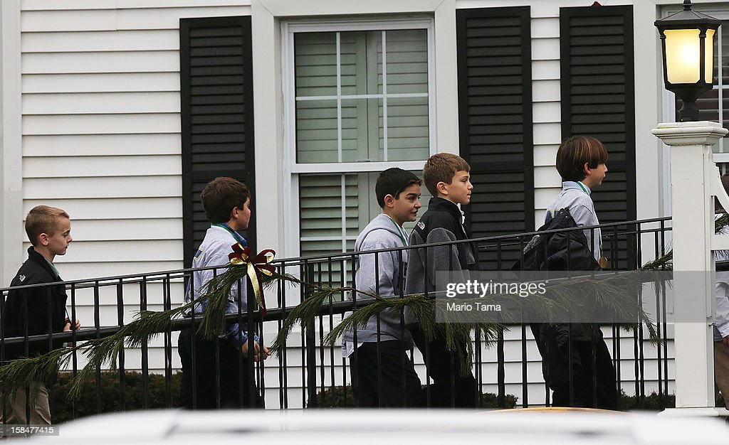 Boys enter Honan Funeral Home before the funeral for six-year-old Jack Pinto on December 17, 2012 in Newtown Connecticut. Pinto was one of the 20 students killed in the Sandy Hook Elementary School mass shooting.