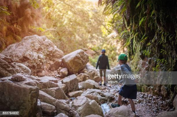 Boys Exploring in Canyon