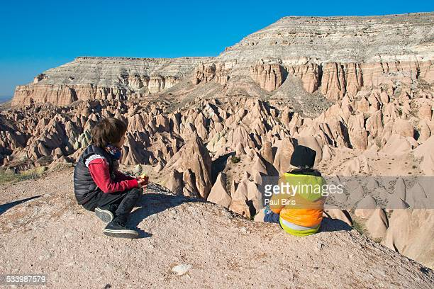 Boys exploring the lunar landscape of Cappadocia