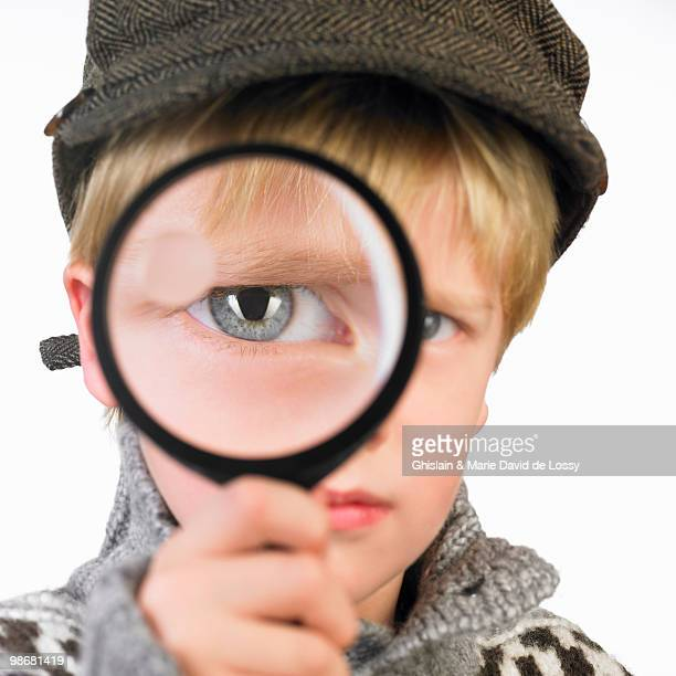 Boy\'s eye through a magnifying glass