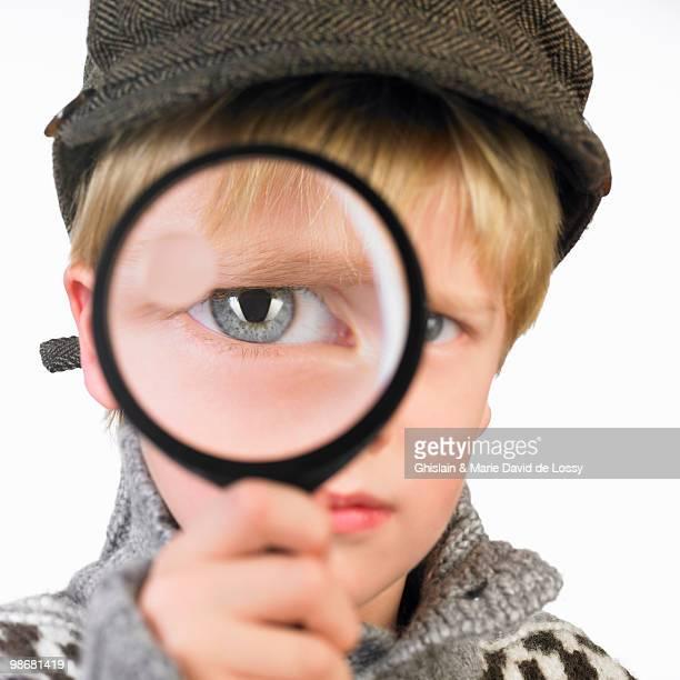 Boy\'s eye through a magnifying glass