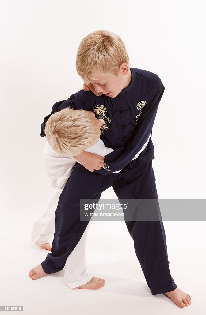 boys fighting in Kung Fu dresses : Stock Photo