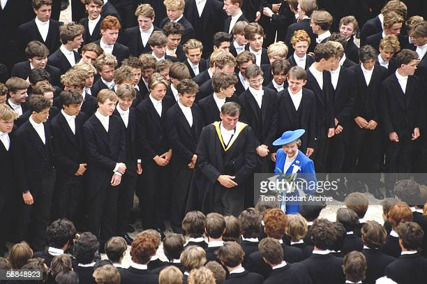 Boys from Eton College welcome HM Queen Elizabeth II during a Royal visit