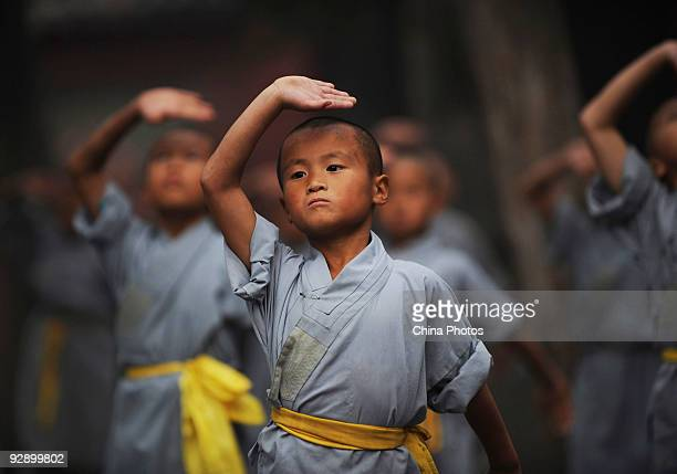 Boys from Shaolin Kung Fu Training Base practice Kung Fu movements at the Shaolin Temple on the Songshan Mountain on October 30 2009 in Dengfeng of...