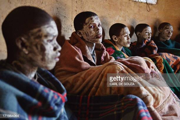 Boys from the Xhosa tribe who have undergone a circumcision ceremony sing inside a hut near Qunu on June 30 2013 Qunu is where former South African...