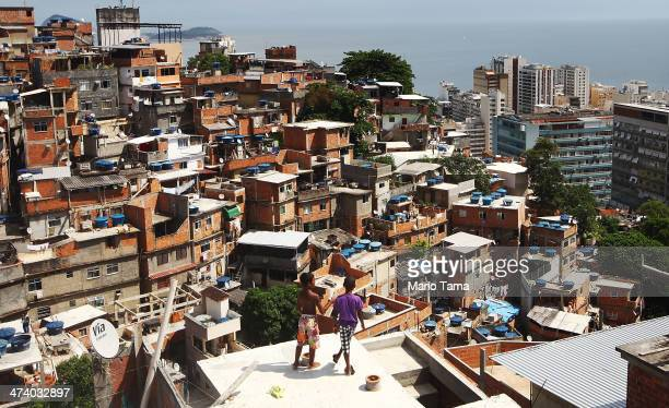 Boys gather while flying kites in the Cantagalo shantytown community next to neighboring PavaoPavaozinho on February 21 2014 in Rio de Janeiro Brazil...
