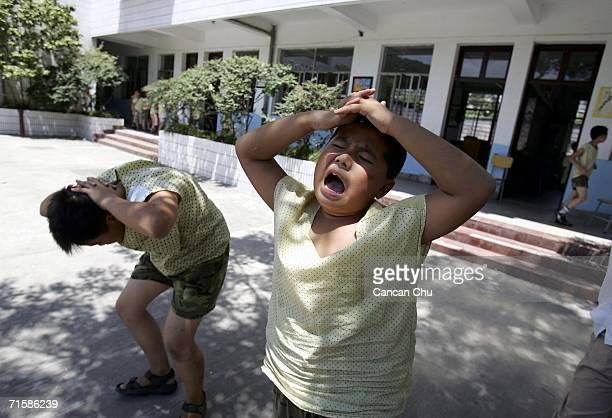 Boys go through daily physical training at the West Point Training Center August 3 2006 in Hangzhou Zhejiang province of China The center named after...
