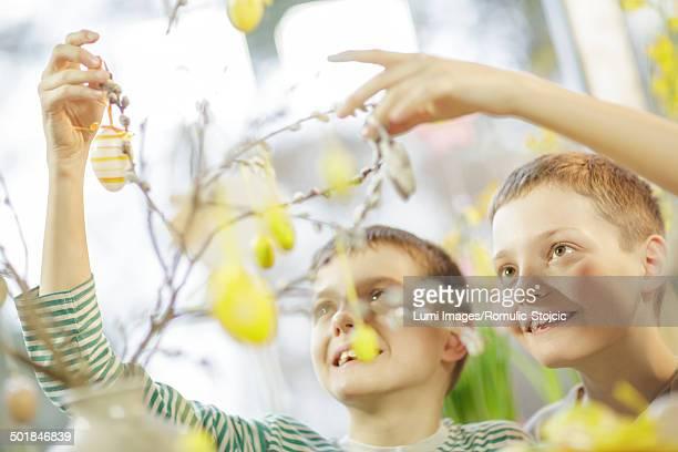 Boys Hanging Easter Decoration, Osijek, Croatia, Europe