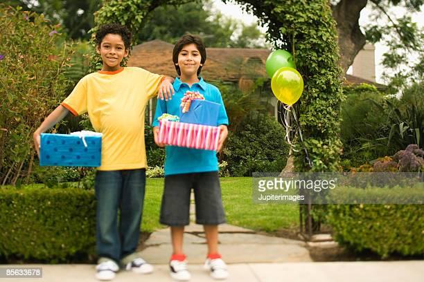 Boys holding birthday presents