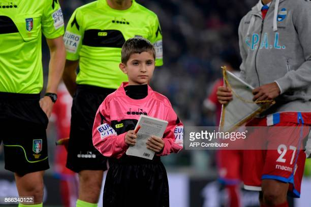 A boys holds a copy of the diary of holocaust victim Anne Frank before the Italian Serie A football match Juventus vs Spal on October 25 2017 at the...