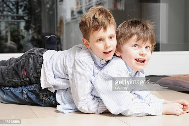 Boys hugging on living room floor