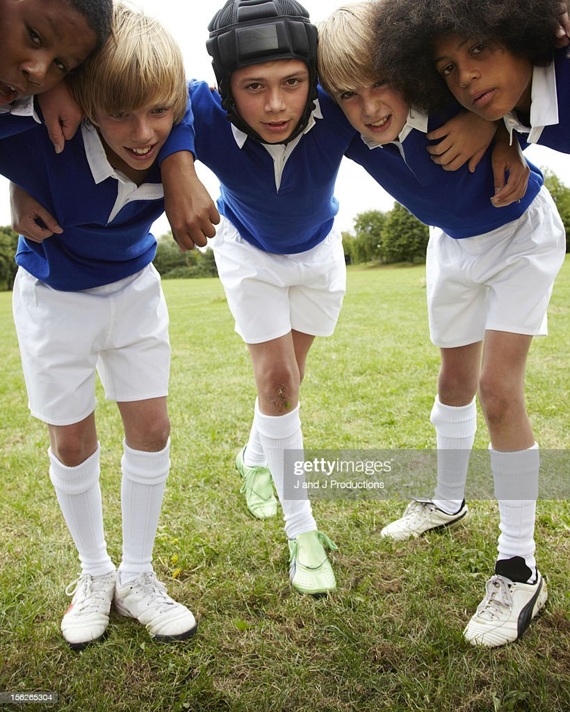 Boys in a rugby scrum : Stock Photo