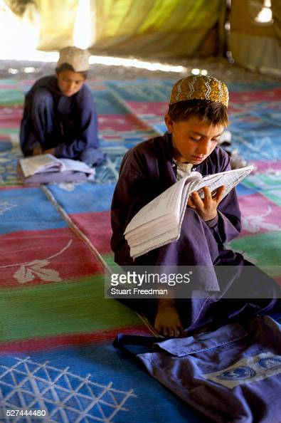 Boys in an Internally Displaced Persons Camp called Zahri Dosht outside of Kandahar learn to read and write under tents
