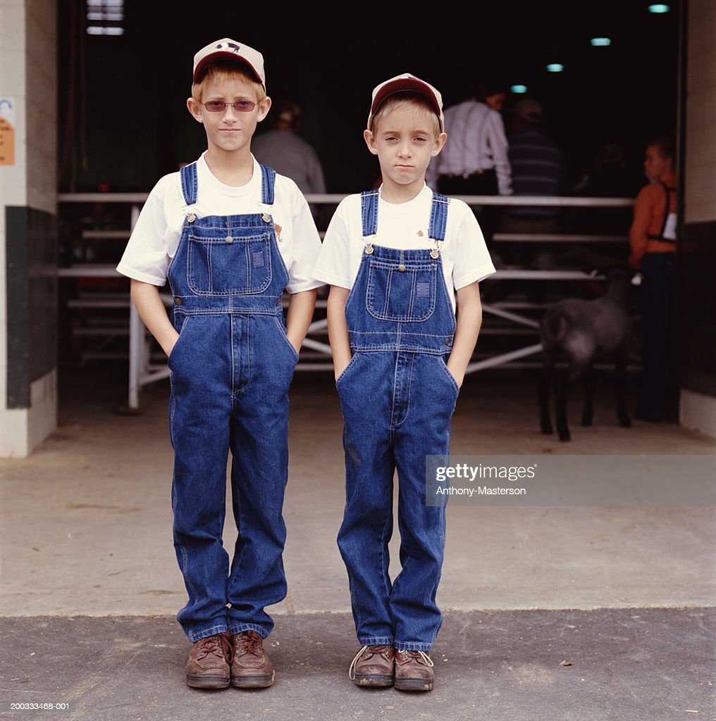 Boys (7-10) in overalls at state fair, portrait : Stock Photo
