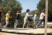boys jump on playground structure