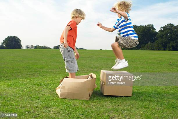 boys jumping on boxes