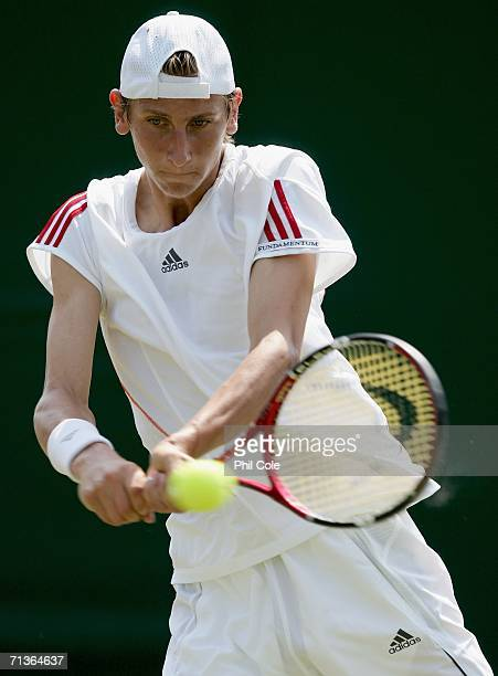 Boys junior player Thiemo De bakker of the Netherlands returns a shot to Antonio Veic of Croatia during day eight of the Wimbledon Lawn Tennis...
