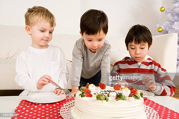 Boys looking at cake