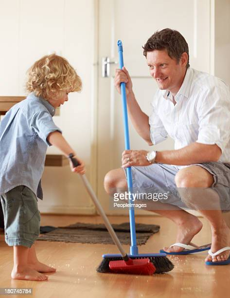 Boys making brooms toys