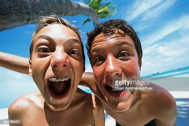 Boys Making Funny Faces on the Beach