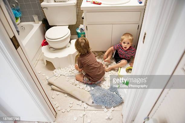 Boys making mess in bathroom