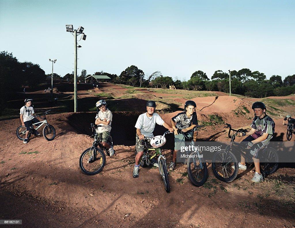 Boys & old man at BMX track : Stock Photo