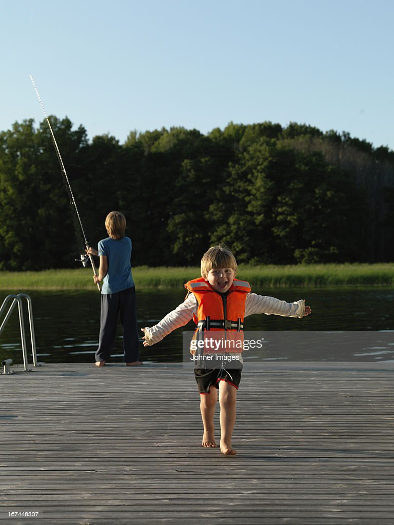 Boys on jetty : Stock Photo