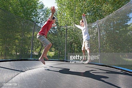 Boys on trampoline : ストックフォト