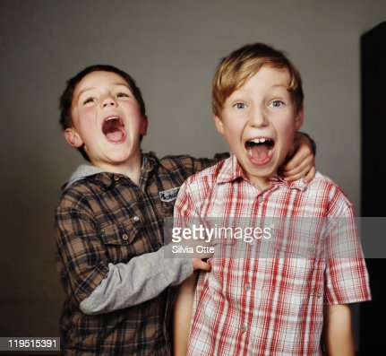 2 boys , one laughing, one screaming : Stock Photo