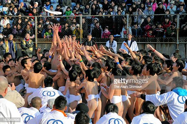 Boys only wear Japanese loincloths fight for grabbing sacred sticks 'Shingi' during the Naked Festival at Saidaiji Temple on February 16 2013 in...