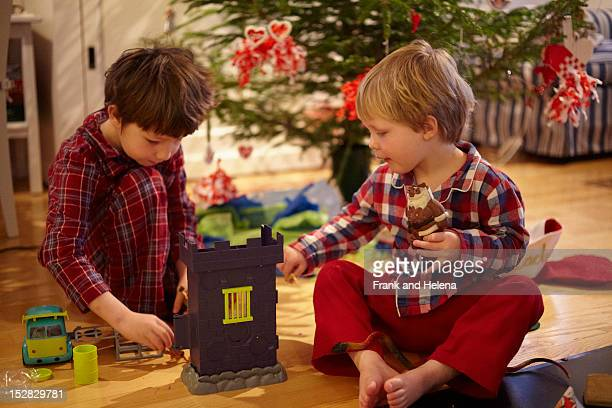 Boys opening Christmas gifts