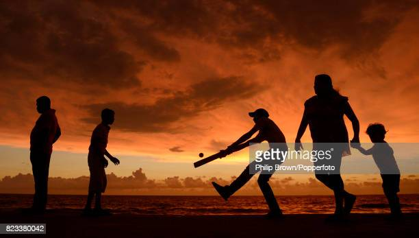 Boys play a game of cricket on Galle Face Green Colombo Sri Lanka on the evening before the ICC World Twenty20 FInal 6th October 2012