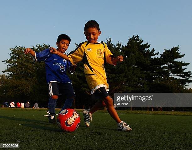 Boys play a pickup game of soccer as their adult relatives participate in the Fedeiguayas Soccer League on September 7 2007 at Flushing Meadows Park...