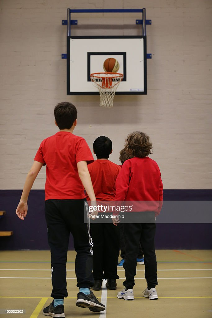 Boys play basketball in the sports hall at a secondary school on December 1, 2014 in London, England. Education funding is expected to be an issue in the general election in 2015.