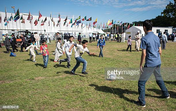 Boys play football as members of the Ahmadiyya Muslim community attend an annual threeday event known as the Jalsa Salana in Hampshire on August 21...
