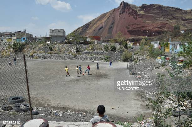 Boys play football in a neighborhood in the Mexico City borough of Iztapalapa on April 19 2017 Dozens of municipal tanker trucks in Mexico City...