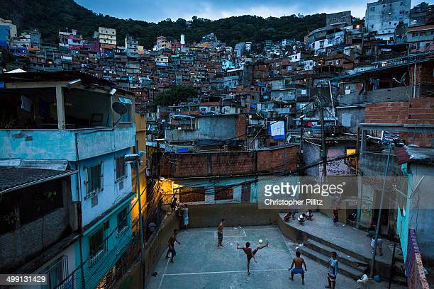 Boys play football in favela, Rio de Janeiro