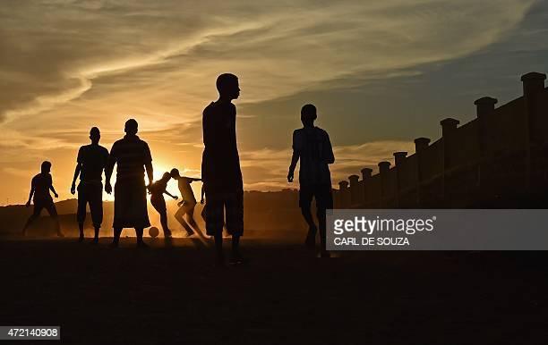 Boys play football in the Balbala area of Djibouti on May 4 2015 AFP PHOTO / CARL DE SOUZA