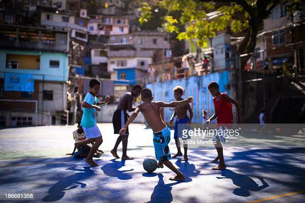 Boys play football in the Borel favela or shantytown on November 2 2013 in Rio de Janeiro Brazil The favela was previously controlled by drug...