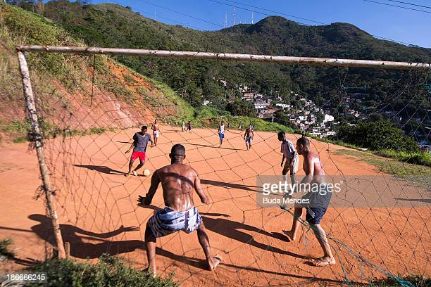 Boys play football in the Formiga favela or shantytown on November 2 2013 in Rio de Janeiro Brazil The favela was previously controlled by drug...