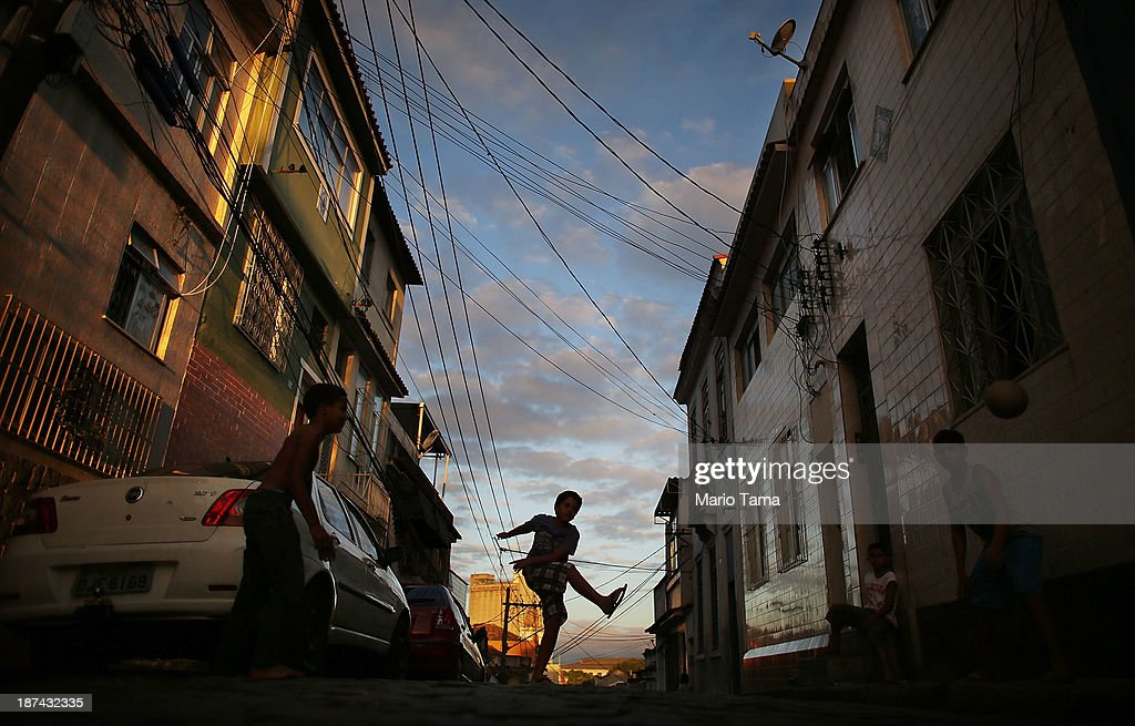 Boys play football in the street before the ceremony deciding Rio's 2014 Carnival Queen and King in the port district on November 8, 2013 in Rio de Janeiro, Brazil. Rio's Carnival runs February 28 through March 4, just three months before the start of the 2014 FIFA World Cup in June.