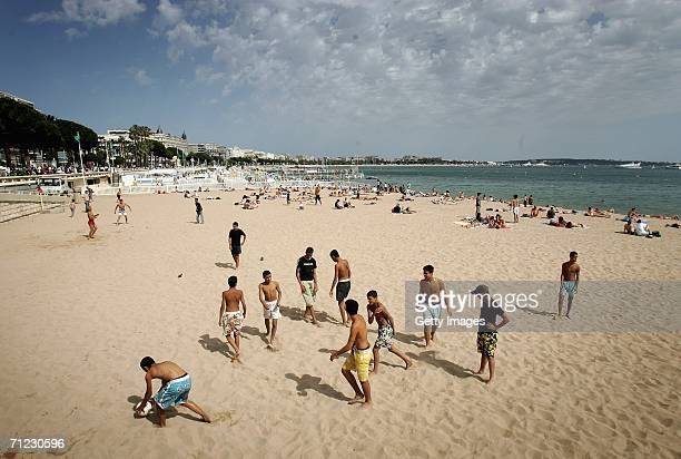 Boys play football on the beach in Cannes on the eve of the 53rd International Advertising Festival on June 17 2006 in Cannes France
