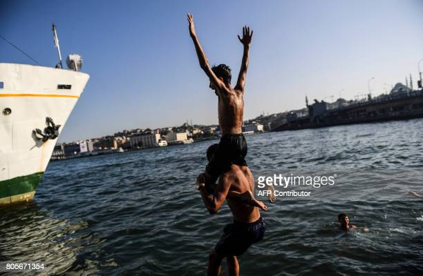 Boys play in the sea at the Galata bridge on July 2 in Istanbul Turkey was sweltering in a weekend heatwave that caused record temperatures in much...