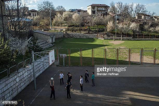 Boys play on a basketball court on April 18 2015 in Shushi NagornoKarabakh Since signing a ceasefire in a war with Azerbaijan in 1994 NagornoKarabakh...
