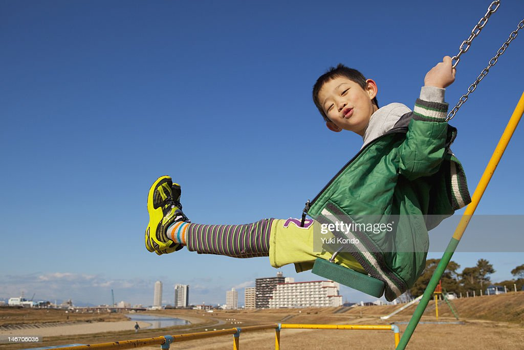 Boys play on the swing. : Stock Photo