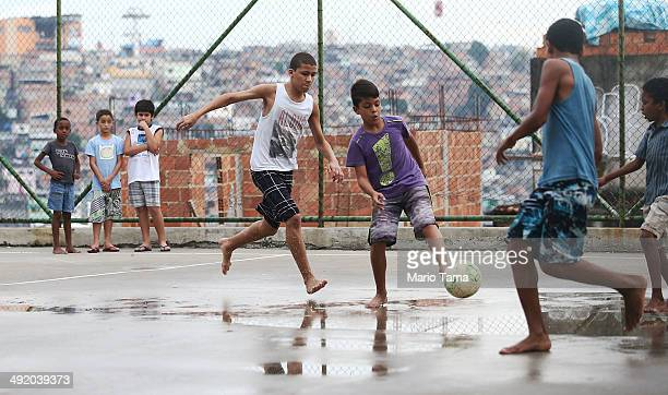 Boys play soccer in the Complexo do Alemao pacified community or 'favela' on May 18 2014 in Rio de Janeiro Brazil Ahead of the 2014 FIFA World Cup...