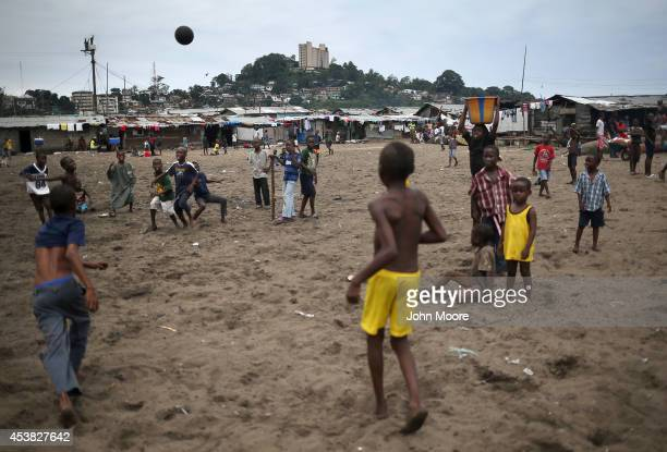 Boys play soccer in the West Point slum on August 19 2014 in Monrovia Liberia With a population of 75000 people in a small area with poor sanitation...