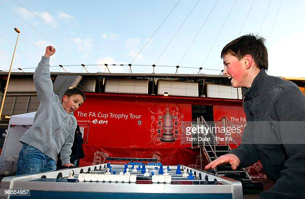 Boys play table football during the FA Cup Trophy Tour at City of Manchester Stadium on February 10 2010 in Manchester England