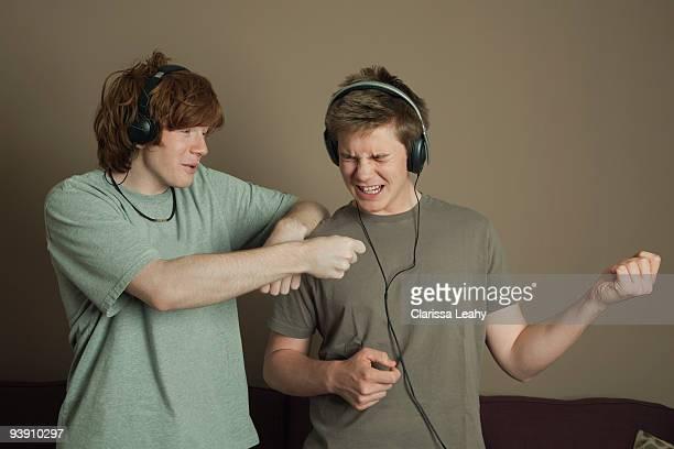 Boys playing air guitars