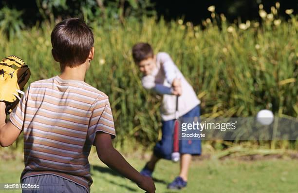 Boys (10-12) playing baseball
